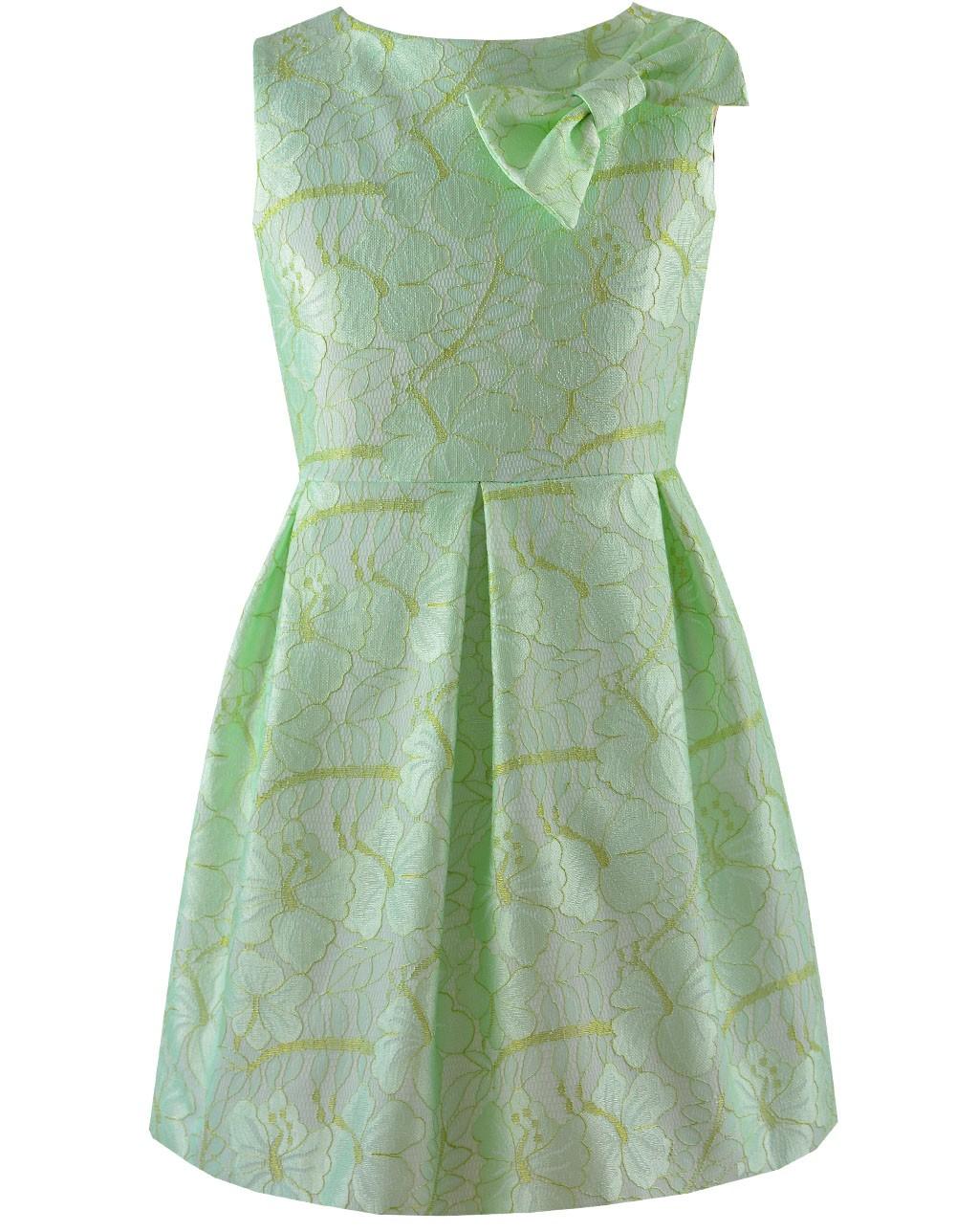 Pistacjowa sukienka z kokardką